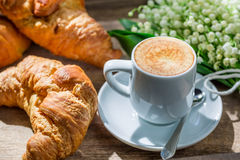 Delicious fresh croissant and hot coffee Royalty Free Stock Photo