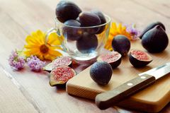 Delicious fresh dark figs on a chopping board Stock Image