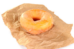 Delicious and fresh donut for breakfast. On a piece of brown paper Stock Photography