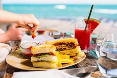 Fish sandwich. Delicious fresh fish sandwich and green salad served for lunch Stock Image