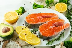 Delicious fresh fish steaks, salmon, trout. With vegetables, deli, vegan food, diet and Dotex stock image