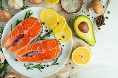 Delicious fresh fish steaks, salmon, trout. With vegetables, deli, vegan food, diet and Dotex royalty free stock photos