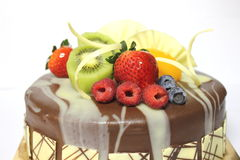 Delicious fresh fruit on chocolete cake. With special decoration Stock Images
