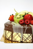Delicious fresh fruit on chocolete cake. With special decoration Stock Photo