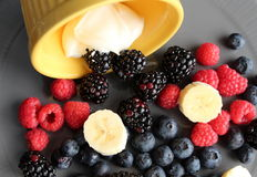 Delicious fresh fruit on gray plate Royalty Free Stock Image