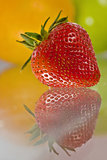 Delicious fresh fruit reflected on glass table Royalty Free Stock Image