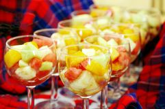 Delicious fresh fruits in glass bowls Royalty Free Stock Photography