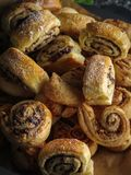 Delicious fresh homemade puff pastry with cinnamon and chocolate Stock Photos