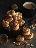 Delicious fresh homemade puff pastry with cinnamon on the wooden Stock Image