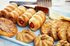 Delicious fresh mouthwatering pastries lay on the table. For sale Stock Photography