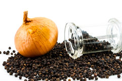 Delicious fresh onion and Glass pepper Grinder Royalty Free Stock Images