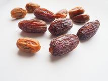 Delicious fresh organic dates over white background Royalty Free Stock Photos