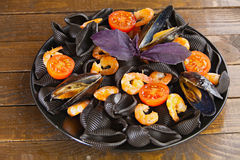 Delicious fresh  pasta Neri on plate with shrimp Royalty Free Stock Images