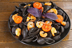 Delicious fresh  pasta Neri on plate with shrimp Royalty Free Stock Photography
