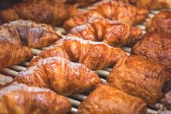 Delicious fresh pastry and croissants in bakery royalty free stock images