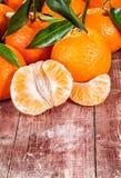 Delicious fresh peeled tangerine or mandarin Stock Images