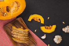 Delicious fresh pieces of ripe pumpkin on wooden background Stock Photo