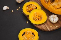 Delicious fresh pieces of ripe pumpkin on wooden background Stock Photography
