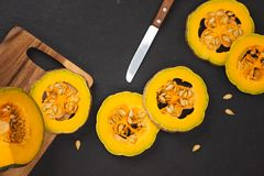 Delicious fresh pieces of ripe pumpkin on wooden background Royalty Free Stock Images