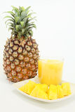 Delicious fresh pineapple. Sliced pineapple with fresh juice and fruit royalty free stock images