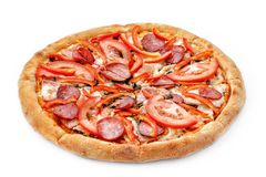 Delicious fresh pizza on a lush dough on a white background. Fresh italian pizza classic original with slices of Royalty Free Stock Image
