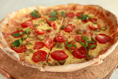 Delicious fresh pizza served on wooden plate Stock Images