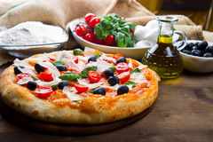Delicious fresh pizza served on wooden table Stock Image