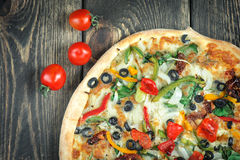 Delicious fresh pizza served on wooden table Royalty Free Stock Images