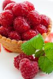 Delicious fresh raspberry tart. Delicious raspberry tart with home grown raspberries and a mint leaf Stock Image