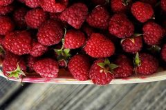 Delicious fresh raspberry in the wooden basket. View Royalty Free Stock Photography