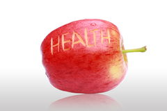 Delicious fresh red apple and health text. Fresh red apple and ''health'' text Stock Images