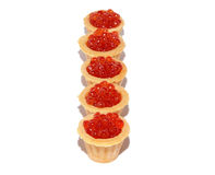 Delicious and fresh red caviar in tartlets. On a white background Royalty Free Stock Photos