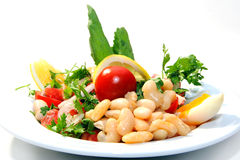 Delicious fresh salad with beans. Tomatoes and lemon Royalty Free Stock Images
