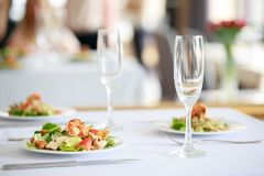 Delicious fresh salad with shrimps in restaurant Stock Photo