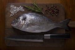 Delicious fresh sea bream fish on a wooden cutting board Stock Image