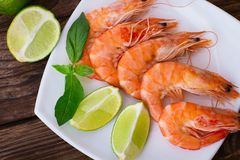 Delicious Fresh Seafood Shrimp With Lime On Wooden Stock Photo
