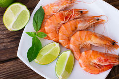 Delicious Fresh Seafood Shrimp With Lime On Wooden Table Top View Royalty Free Stock Photography