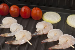 Delicious fresh shrimp on a grill peeled Stock Photos