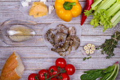 Delicious fresh shrimps and vegetables on wooden background. Royalty Free Stock Photo