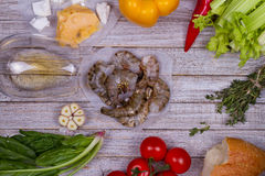 Delicious fresh shrimps and vegetables on wooden background. Royalty Free Stock Photography