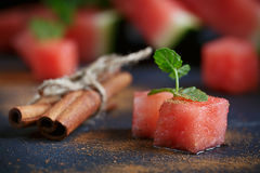 Delicious fresh slices of watermelon with cinnamon. On the dark background Stock Photo