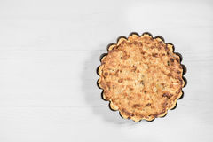 Delicious fresh sour cream pie on a wooden light background, iso Stock Photos