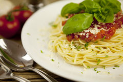 Delicious fresh spaghetti with tomato sauce and parmesan on table Royalty Free Stock Image