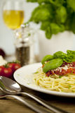 Delicious fresh spaghetti with tomato sauce and parmesan on table Stock Photography