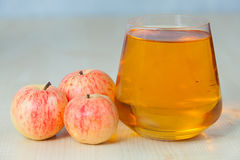 Delicious fresh squeezed apple juice in  transparent glass Royalty Free Stock Images