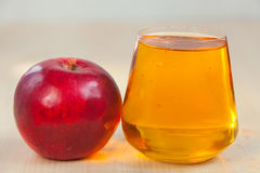 Delicious fresh squeezed apple juice in  transparent glass Stock Images