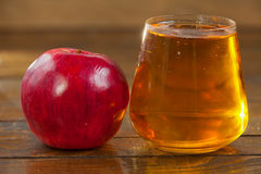 Delicious fresh squeezed apple juice in  transparent glass Royalty Free Stock Photography