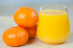 Delicious fresh squeezed tangerine juice in  transparent glass Stock Photography