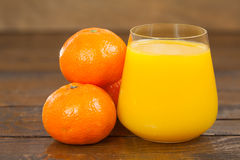 Delicious fresh squeezed tangerine juice in  transparent glass Royalty Free Stock Photos