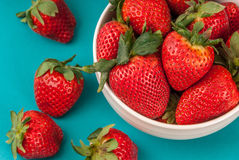 Delicious fresh strawberries in a white bowl Stock Photography